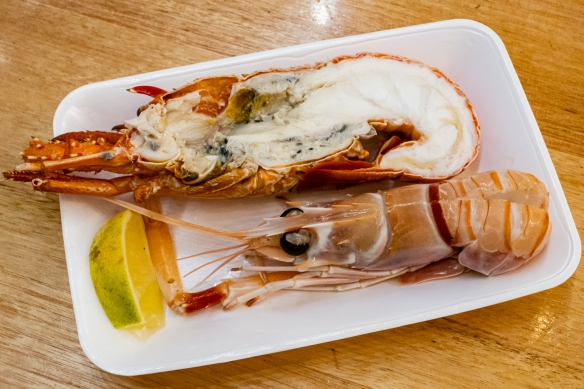 For lunch at Peter's Sydney Fish Market, we each started with one half of a cooked lobster and a sushi grade scampi, Sydney Fish Market, Sydney, New South Wales, Australia